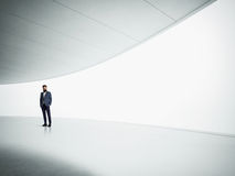 Yound hipster in the modern white interior Royalty Free Stock Image