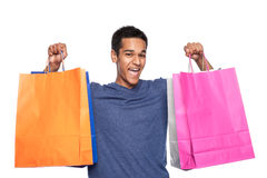 Yound Man with Shopping Bags. Young man with colourful shopping bags. Studio shot on white background stock image