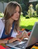 Yound pretty Russian model with notebook in garden Stock Images