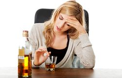 Yound woman in depression, drinking alcohol Royalty Free Stock Image