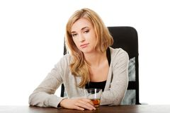 Yound woman in depression, drinking alcohol Royalty Free Stock Photos