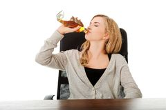 Yound woman in depression, drinking alcohol Stock Photo