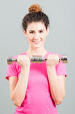 Yound woman doing weight training with dumbbells Stock Photo