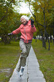 Yound woman in red jacket jumps and have a fun Royalty Free Stock Photos