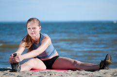 Younf woman doing stretching exercise. Yoga Stock Image
