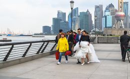 Young сhinese couple in wedding dress walking along the promenade at the Bund stock images