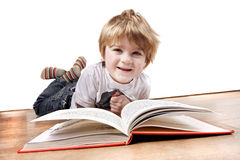 Young 4 year old boy reading a book Royalty Free Stock Images