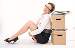 Young. Attractive businesswoman next to pile of documents, lots of copy space royalty free stock images