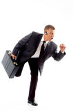 Young accountant holding bag in walking posture Royalty Free Stock Photos