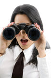 Young accountant looking through binocular Royalty Free Stock Images