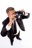 Young accountant looking through binoculars Royalty Free Stock Image