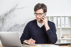 Young accountant on phone Stock Photography