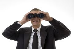 Young accountant viewing through binoculars Royalty Free Stock Image