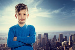 Young Achieve. Young Boy in front of the big city Stock Photography