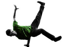 Young acrobatic break dancer breakdancing man silhouette. One caucasian young acrobatic break dancer breakdancing man in silhouette  white background Stock Photography