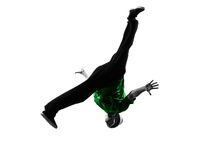 Young acrobatic break dancer breakdancing man silhouette. One caucasian young acrobatic break dancer breakdancing man in silhouette  white background Stock Images