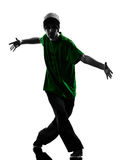 Young acrobatic break dancer breakdancing man silhouette. One caucasian young acrobatic break dancer breakdancing man in silhouette  white background Stock Photo