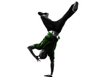 Young acrobatic break dancer breakdancing man silhouette. One caucasian young acrobatic break dancer breakdancing man in silhouette  white background Royalty Free Stock Photo