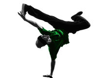 Young acrobatic break dancer breakdancing man silhouette. One  young acrobatic break dancer breakdancing man in silhouette white background Royalty Free Stock Images