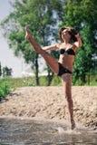 Young acrobatic girl Stock Image