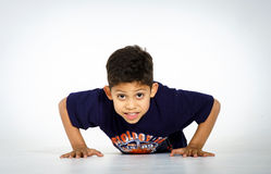 Young active afro-american boy doing gymnastics Royalty Free Stock Photos