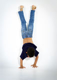 Young active afro-american boy doing gymnastics Stock Images