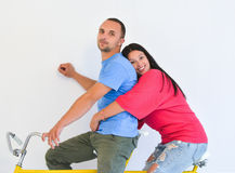 Young active couple doing sports. Isolated on white Stock Photography