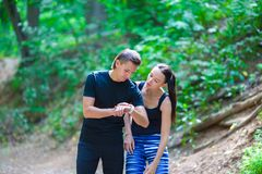 Young active couple looking at smart watch heart Stock Photo