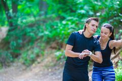 Young active couple looking at smart watch heart Royalty Free Stock Photography