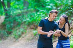 Young active couple looking at smart watch heart Royalty Free Stock Image