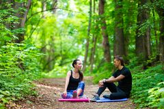 Young active couple making stretching yoga Stock Images