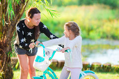 Young active family biking at summer day. Family of father and kid biking at summer vacation Stock Photos