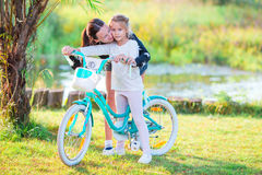 Young active family biking at summer day. Family of father and kid biking at summer vacation Royalty Free Stock Images