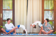 Young active family doing acrobatics on the terrace Stock Photos