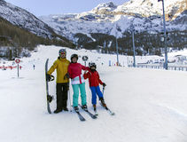 Young active family enjoys winter sports in the charming Swiss resort of Saas-Fee Stock Photo