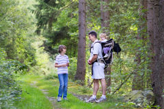 Young active father hiking in cliff and forest with kids Stock Images