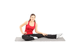 Young active female posing on a mat Stock Photos