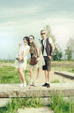 Young active girls and guy hipsters have fun outdoors Stock Photo