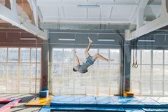 Young active guy performing the flips stock photography