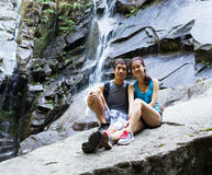 Young Active Hikers Resting Near Waterfalls Royalty Free Stock Photo