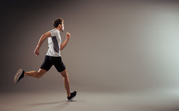 Young, active jogger running - isolated royalty free stock image