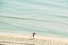 Young, Active Man in His 30's Exercising on the Beach Stock Photography