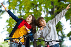 Young active people biking Stock Images