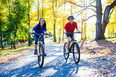 Young active people biking Stock Photo