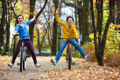 Young active people biking Stock Photos