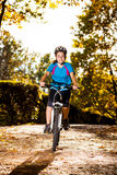 Young active people biking Royalty Free Stock Images