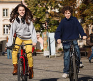 Young active people biking Royalty Free Stock Image