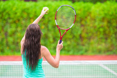 Young active sporty woman playing tennis on Stock Images