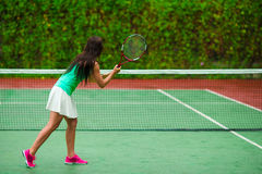 Young active sporty woman playing tennis on Stock Photos