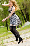 Young active woman in city park. Pretty young active woman in city park Stock Photography